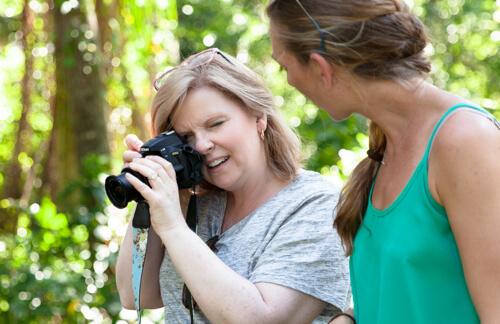 Woman taking DSLR Photography lesson