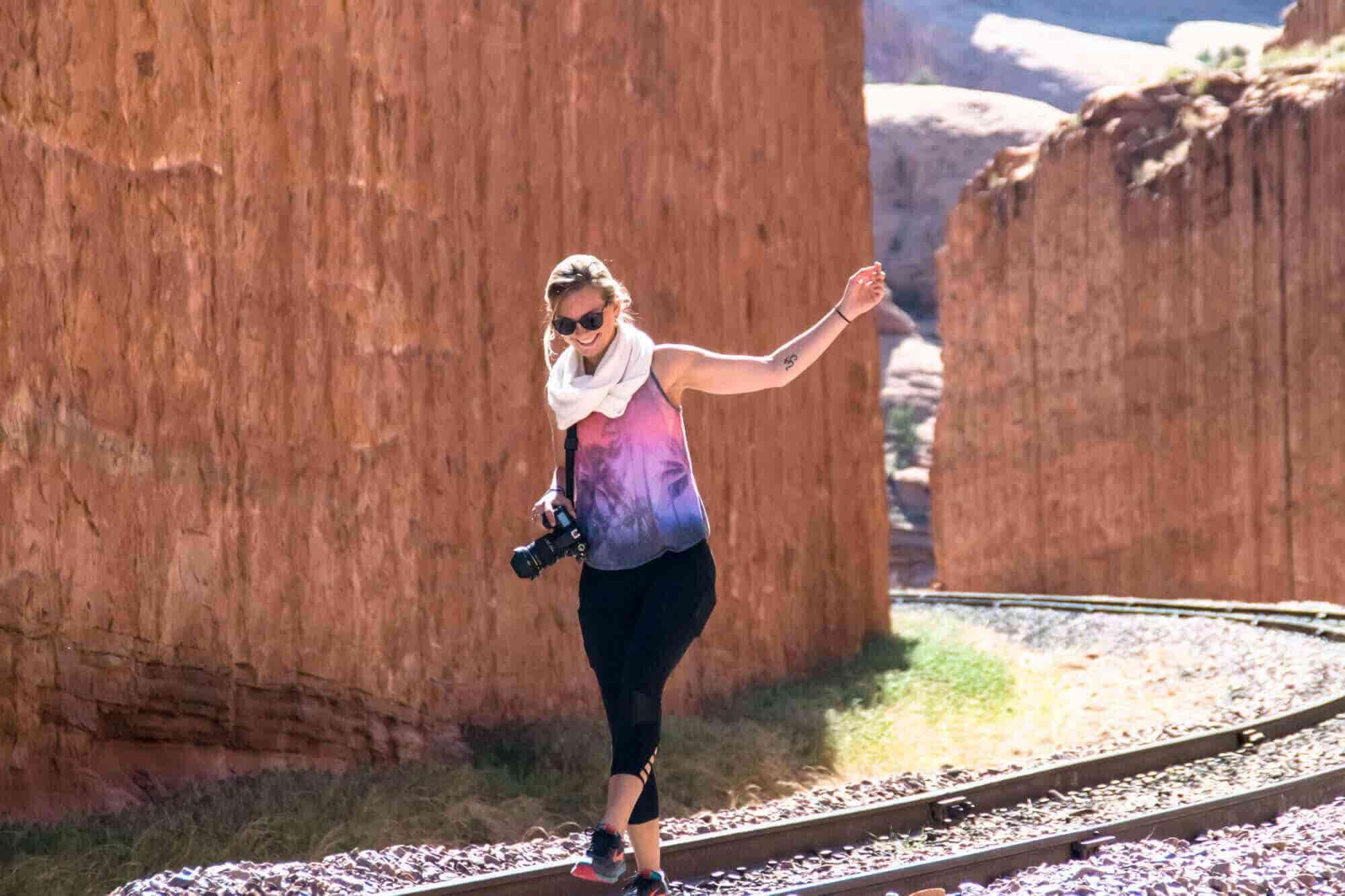 Girl walking on railway line