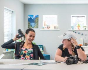 Two photographer women talking