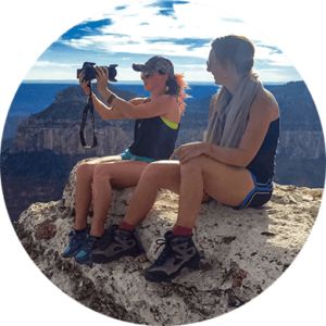 Two girls taking photos