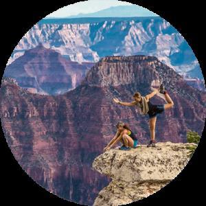 two girl posing on mountain